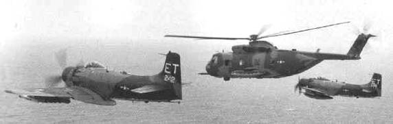 Rescue Team: a Sikorsky CH-53 Helicopter being escorted by a pair of Douglas A-1 Skyraiders, Laos, 1972.